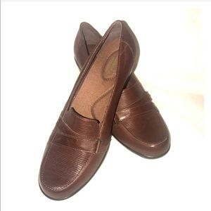 Brown Clarks bendables heeled loafers.